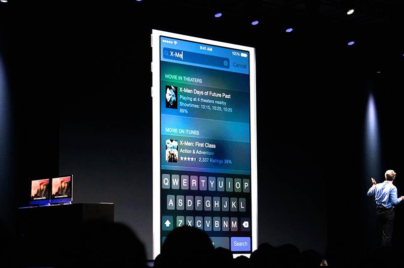 プレゼン後半、iOS 8のパートで紹介されたSpotlight。こちらもローカルな情報とネットの情報を串刺しで検索できるようになっている。画像は、「X-Men」をキーワードにした例で、ビデオがピックアップされているところに注目