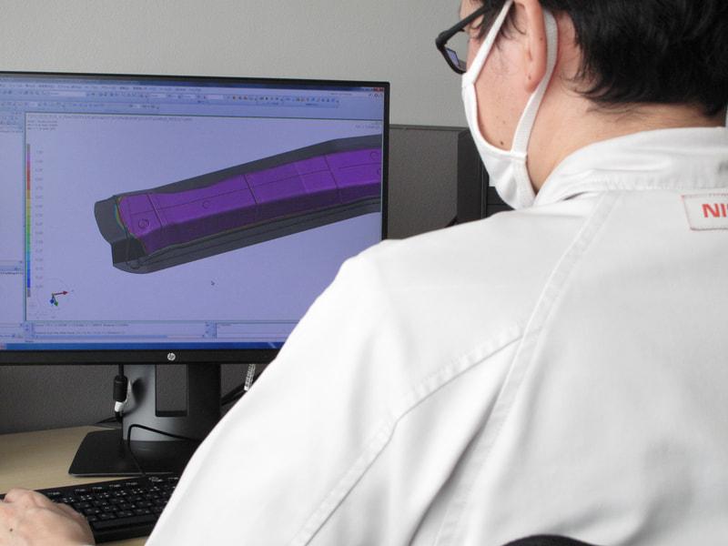 可視化した樹脂の流れから、炭素繊維への樹脂の含浸度合いを高精度にシミュレーションする技術を開発