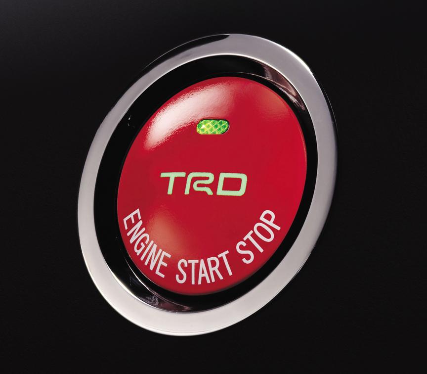 「プッシュスタートスイッチ」。スイッチ中央にTRDのロゴが入る。つや消し赤塗装。スマートエントリー装着車に適合する。1万4700円