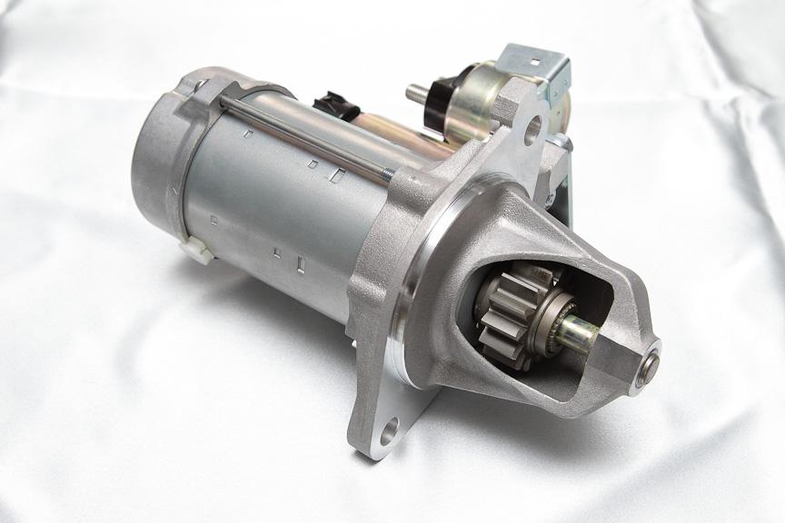 エンジンが完全停止する前に再始動を可能とする新開発のスターターモーター
