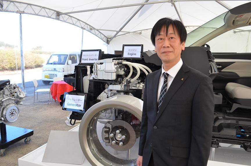 三菱自動車 開発本部EV・パワートレインシステム技術部エキスパート(EVシステム設計担当)の大久保博生氏。アウトランダーPHEVのハイブリッド・システムの開発を担当した。もともとガソリン・エンジン担当であったが「i-MiEVに乗って、EVのよさに感動。志願してEV・ハイブリッドの開発に来ました」と言う