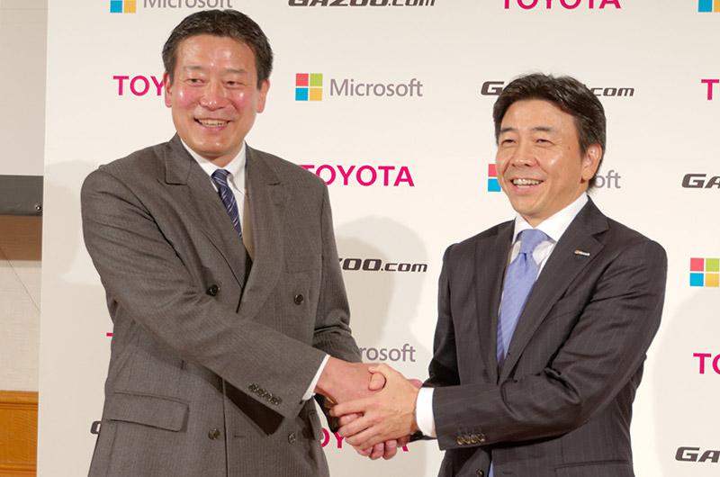 トヨタ自動車 e-TOYOTA部 部長 山田博之氏(左)、日本マイクロソフト 執行役常務 エンタープライズビジネス担当 小原琢哉氏(右)