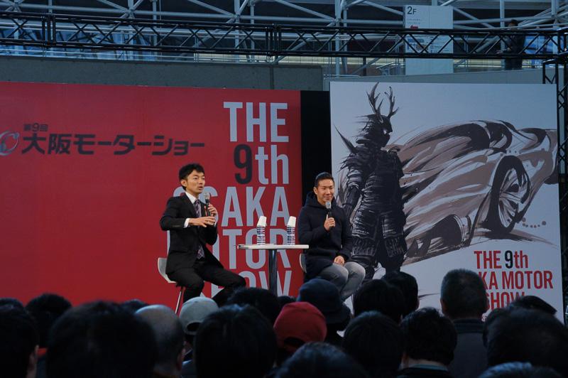 「第9回大阪モーターショー」が12月4日に開幕。開幕初日は小林可夢偉選手がトークイベントに登場。期間中メインステージでは様々なイベントが行なわれる