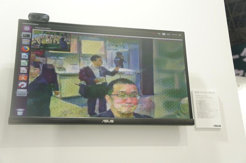 機械学習による画像処理によりブース内の動画映像をリアルタイムに名画風のタッチにするところをデモ