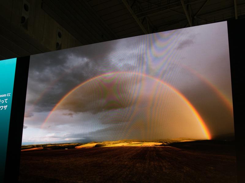 写真に写る虹は「かけるもの」だと中西さんは話す。