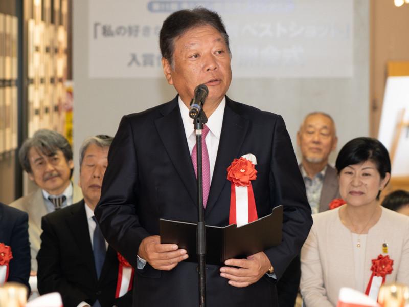 株式会社タムロン代表取締役社長の鯵坂司郎氏。