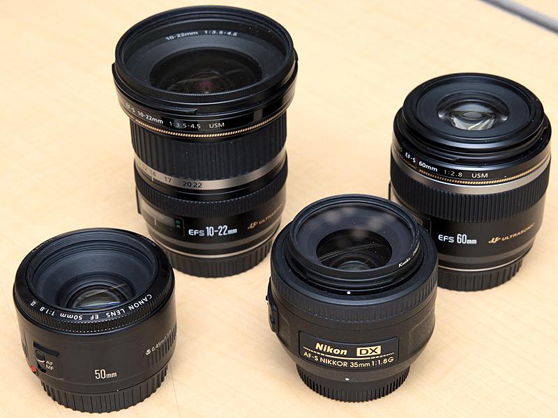 <STRONG>GUNPがこれまでに購入したレンズ。「EF-S 10-22mm F3.5-4.5 USM」(左上)、「EF-S 60mm F2.8 Macro USM」(右上)、「EF 50mm F1.8 II」(左下)、「AF-S DX NIKKOR 35mm F1.8 G」(右下)</STRONG>