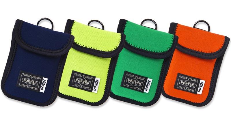 <b>Nikon x PORTERストレッチソフトケース。左からネイビー、ライム、グリーン、オレンジ</b>