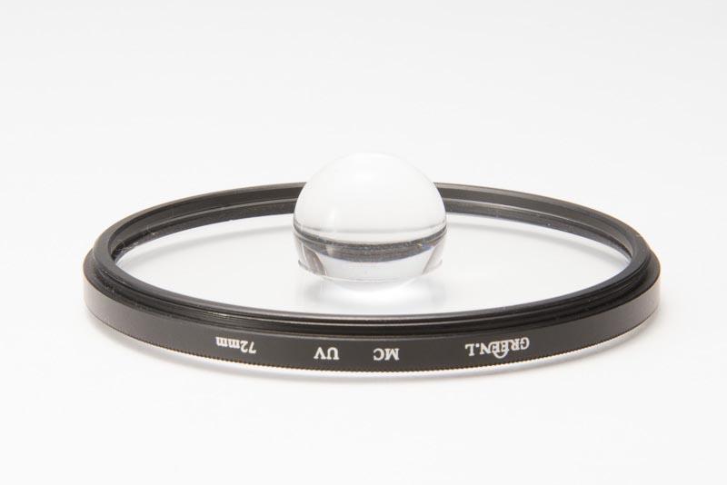 GREEN.LのMC UVフィルター(72mm)のガラスを外して宙玉レンズをはめた。フィルターによりガラスが外しやすいものや外しにくいものがある。これはカニ目タイプだったので、デバイダーを使って簡単に外すことができた。