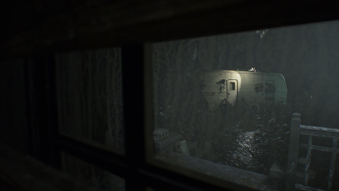 窓から見えるトレーラーハウス