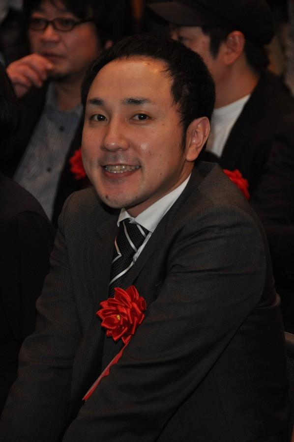 開発を代表して出席した松山洋氏(上画像・最左)。ブース内では、劇場版クオリティで動き回るキャラクタに来場者の多くが目を奪われていた