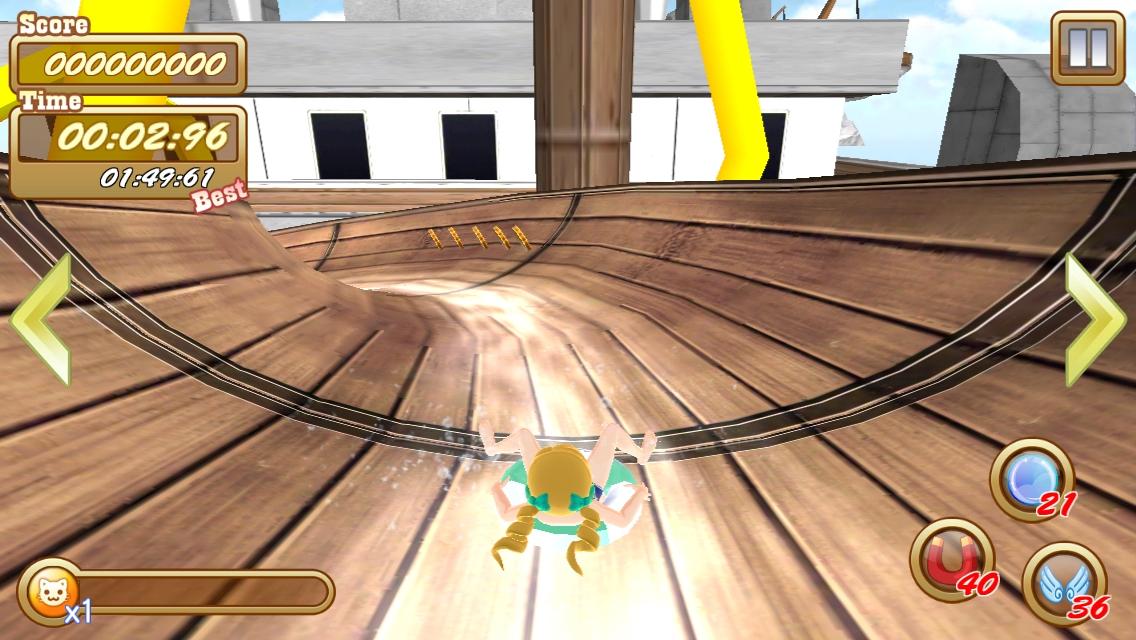 女の子が浮き輪に乗って、巨大滑り台を滑っていく