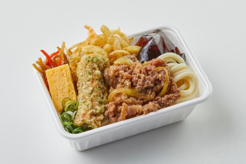 「2種の天ぷらと定番おかずの肉うどん弁当」(650円)