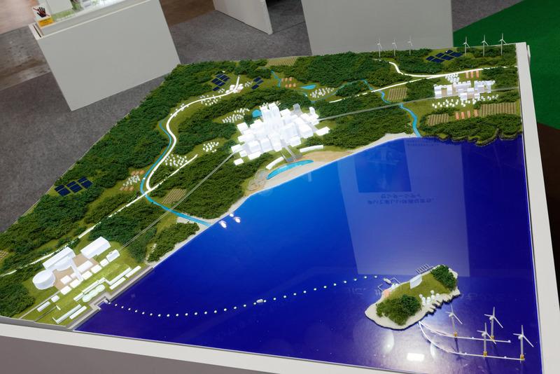2030年の街づくりの例。手前の離島の沖合で洋上発電し、電力を街に伝送。もしくは水素に変換して販売する