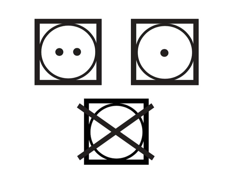 上の2つの記号がタンブル乾燥できることを表す記号。点の数が乾燥温度を表し、左上の「・・」はヒーターを「強(排気温度上限80℃)」などに、右上の「・」では同じく「弱(排気温度上限60℃)」に設定できる