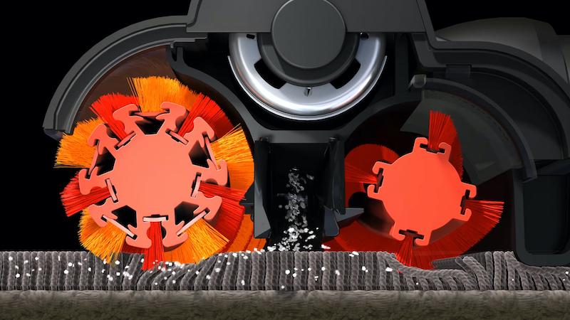 逆方向に回転する前後2本のブラシが、中央の吸引口に向かってゴミをかき込む
