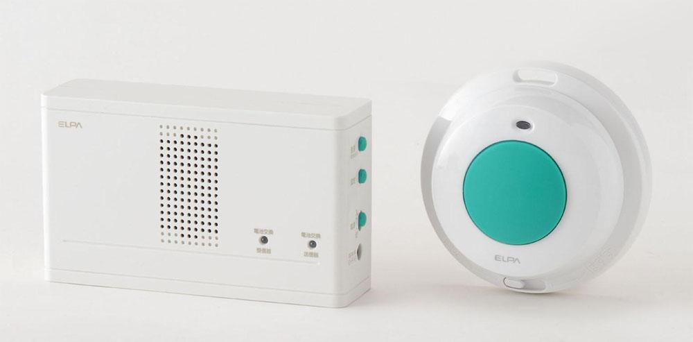 ワイヤレスチャイム 防水押しボタン送信器セット。左が受信器、右が送信器
