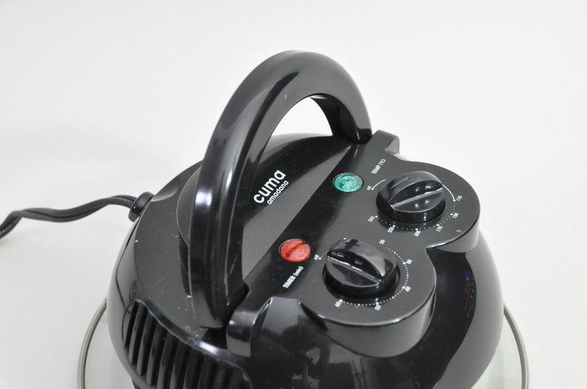 上蓋はハンドルで持ち上げることが可能。ハンドルが完全に降りていないと電源が切れる仕組み