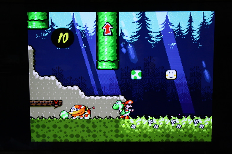 「ヨッシーアイランド」は恐竜ヨッシーが赤ちゃんマリオを背中に乗せて活躍するアクションゲームだ