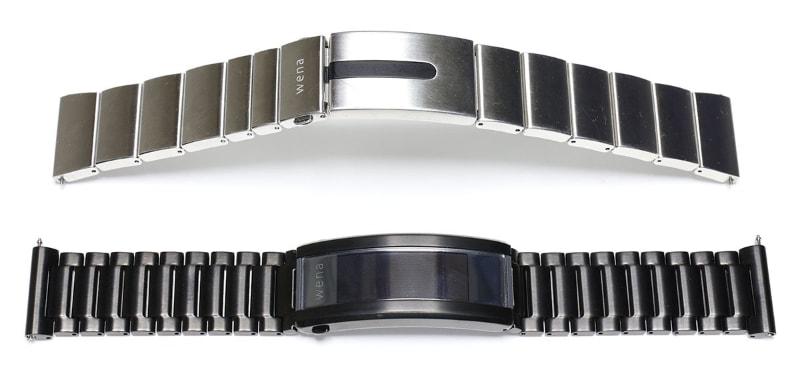 銀色の方が従来モデルwena wrist proで、黒い方が最新モデルwena 3 metal。wena wrist proは時計バンドとしてはけっこうゴツく、バンドの柔軟さは十分ではあるが、その過剰気味の重厚さにやや違和感があった。wena 3ではそういった違和感が大きく解消され、より自然な装着感となっている。wena wrist proはバックルおよび数個のコマに回路などが組み込まれていたが、wena 3ではバックル内のみに回路などを実装。そんな差異が、バンドの着け心地の差につながっている。