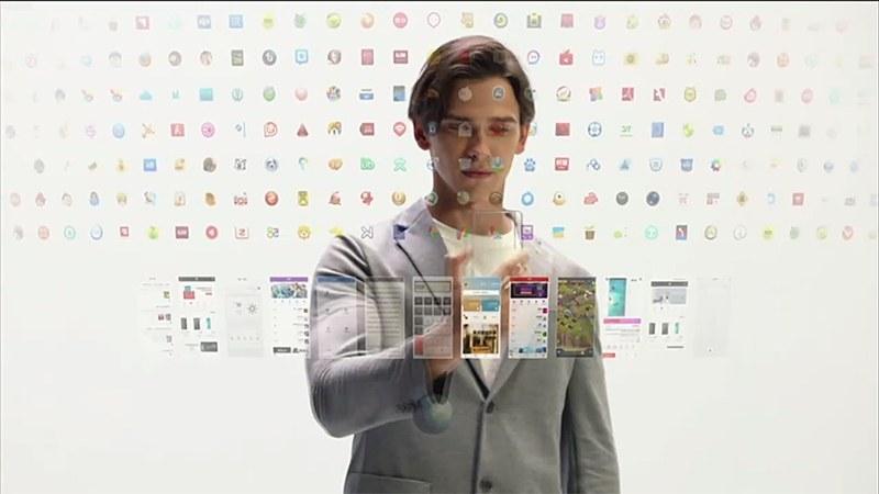 無限屏のイメージ。広大な仮想デスクトップのなかを、スマートフォン本体を移動させてコンテンツを探すイメージだ