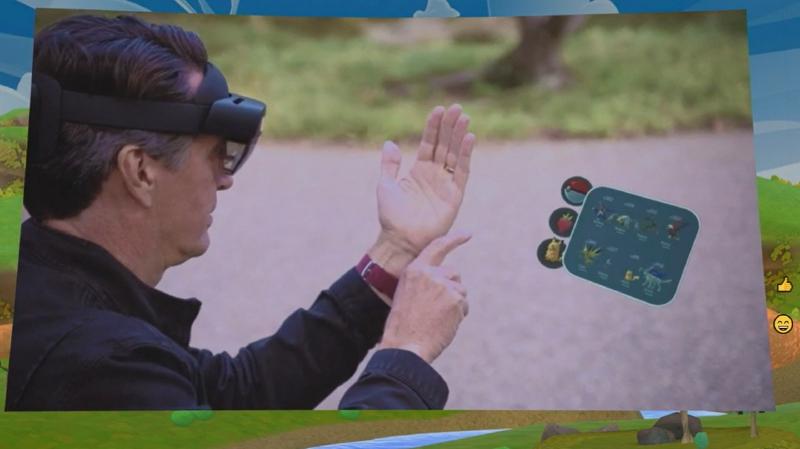 Pokémon GoのHololens用PoC版のデモ、Hololensを被ったまま街に出るかという議論はおいておくとして、印象的なデモであることは間違いない。公園にいるピカチュウに餌をあげることができる(Igniteの基調講演より筆者キャプチャ)