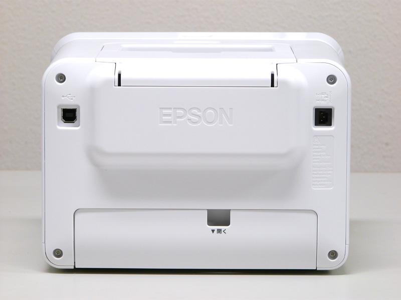リア。USB 2.0(PC用)と電源入力、下のパネルを開いてインクカセットを入れる