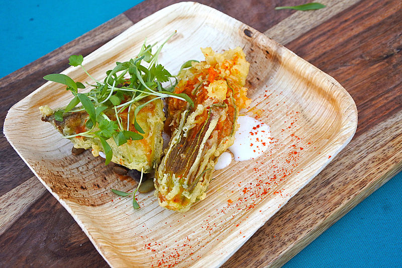 「Local Kabocha Squash Tostada with Black Beans, Fried Avocado, Maui Surfing Goat Cheese, and Spiced Pepitas」
