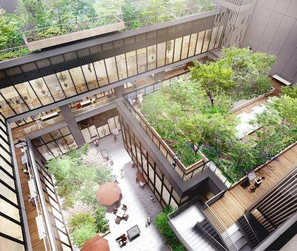 八幡通りから緑豊かな中庭を経由するアプローチ