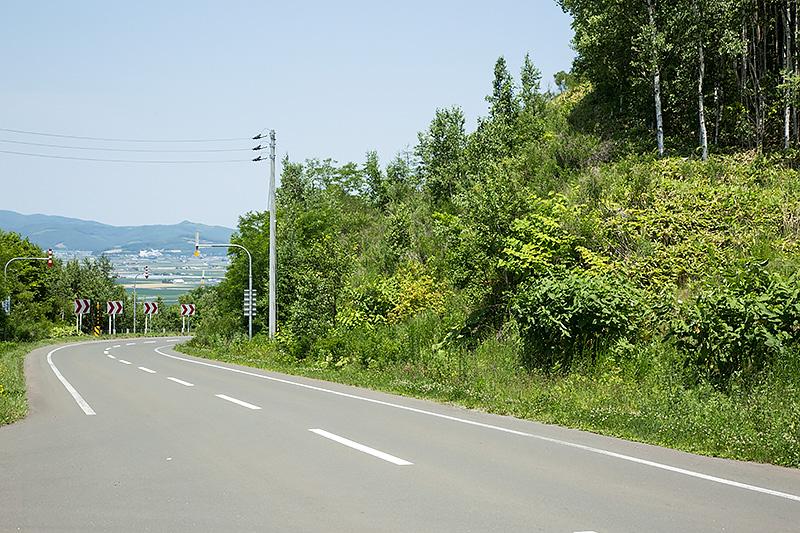 大里れいの自転車のチェーンが外れた辺り。現在は舗装路となっている